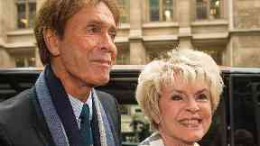 Sir Cliff Richard arrives with Gloria Hunniford at the Rolls Building in London, to give evidence in a legal battle against the BBC.