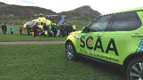 Scotland's charity air ambulance lands at Holyrood Park outside Scottish Parliament April 24 2018