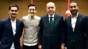 Premier League footballers Ilkay Gundogan, Mesut Ozil and Cenk Tosun pose with Turkish President Recep Tayyip Erdogan.