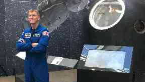 Tim Peake with his Soyuz descent module at the National Museum of Scotland.