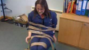 Whistleblower DeeAnn Fitzpatrick allegedly gagged and taped to chair.