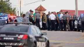 US restaurant gunman shot dead by passers-by had gun licence