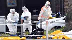 Forensic police investigate at the scene of a shooting in Liege.
