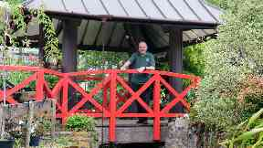 Cardwell's retail general manager, Paul Carmichael at the bridge and pagoda-style shelter that came from the Glasgow Garden Festival and is now at Cardwell Garden Centre.