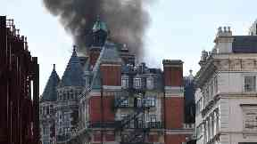 Nearly 100 firefighters tackle large blaze at luxury London hotel