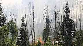 Colorado wildfire doubles in size during hot and windy weather