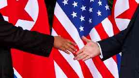In pictures: Donald Trump and Kim Jong Un meet for first time