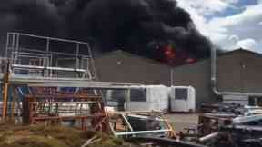 Blaze: Smoke seen for miles. Gray & Adams Fraserburgh