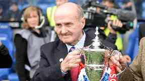 Rangers legend Johnny Hubbard presents the Scottish League One trophy