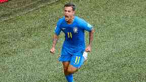 Coutinho celebrates after opening the scoring for Brazil.