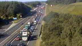 M8 eastbound delays after lorry sheds load at Deerpark Roundabout.
