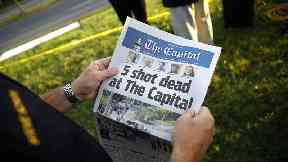 Maryland newspaper shooting suspect 'barricaded exit'