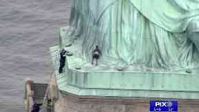 Statue of Liberty evacuated after immigration protest