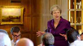 Inside the Chequers talks: Pictures show Theresa May setting out Brexit plans