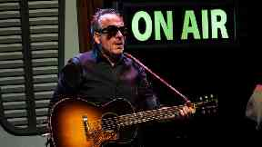 Elvis Costello urges other men to seek help after cancer surgery ends his European tour