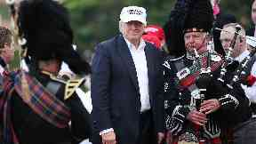 Donald Trump with bagpipers at Turnberry, Scotland