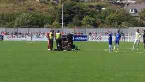 Cove Rangers player Jordon Brown injured in match against Aberdeen.