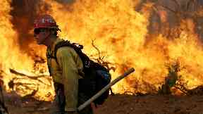 Firefighters struggle to contain deadly California wildfires