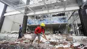 Dozens killed as powerful earthquake hits Indonesian tourist island