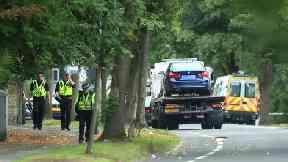 Police officers near the scene of the crash in Bradford.