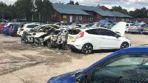 Vehicles torched in prison car park