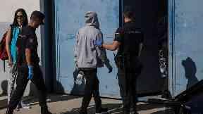 Migrants are led into the Migrants Reception Centre near Algerciras.