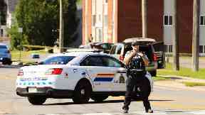 Two police among four people dead after Canada shooting