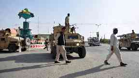 Afghan forces battle Taliban for key city for fourth day