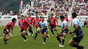 Yamaha Jubilo's Kira Tomokazu carry the ball during a memorial rugby match against Kamaishi Seawaves.
