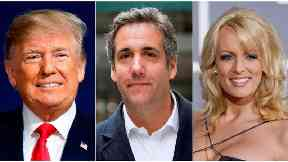 Michael Cohen (centre) say he paid off two woman at Donald Trump's direction.