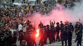 Protesters light fireworks during a far-right demonstration.