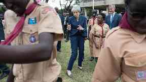 Theresa May breaks out dance moves again on Africa trip
