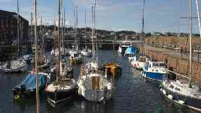 Berwick Harbour: Woman pulled from water.