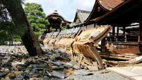 Japan surveys damage after 100mph typhoon causes devastation