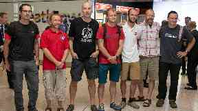 Divers from the rescue mission, from left to right: Chris Jewell, Mike Clayton, Rick Stanton, Lance-corporal Connor Rae, Josh Bratchley, Gary Mitchell and Jim Way who helped to save 12 schoolboys and their football coach from a flooded cave in Thailand, speak to media after arriving back at London's Heathrow Airport.
