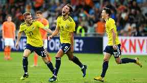 At the double: Fraser Hornby (centre) celebrates after scoring for Scotland U21s against Holland.