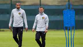 Assistants: Thierry Henry and Shaun Maloney help out Belgium boss Roberto Martinez.