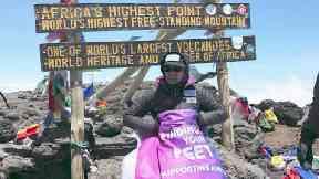 Corinne Hutton at the Kilimanjaro summit, 2018