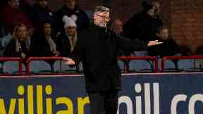 Craig Levein watched his side win 3-0.