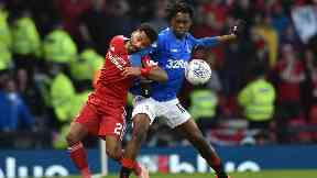 Battle: Shay Logan (left) battles with Rangers' Ovie Ejaria for the ball.