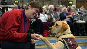 Deaf congregation - Rev Mary Whittaker with her constant companion – hearing dog, Scott