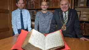 Aberdeen Lord Provost Barney Crockett with the sixteenth century Council Register, which references The William boat