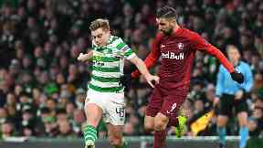 Challenge: James Forrest vies with Salzburg striker Mounes Dabbur for possesion.