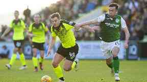 Battle: James Forrest looks to evade Stevie Mallan during Celtic's loss at Hibs.