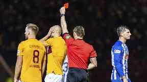 Red: Referee Steven McLean sends off Motherwell striker Curtis Main.