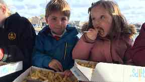 Archie Brown and Alice Shakespeare enjoying fish and chips from The Quayside in Gourdon, Aberdeenshire