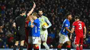 Booked: Referee Kevin Clancy shows Alfredo Morelos a yellow card.