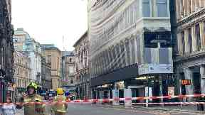 Emergency: Crews taped off the scene in Glasgow.