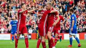 Sam Cosgrove scored a hat-trick as Aberdeen cruised through.