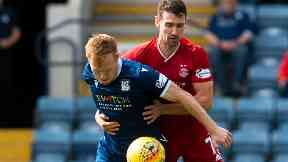 Dundee's Danny Johnson holds off Aberdeen's Craig Bryson